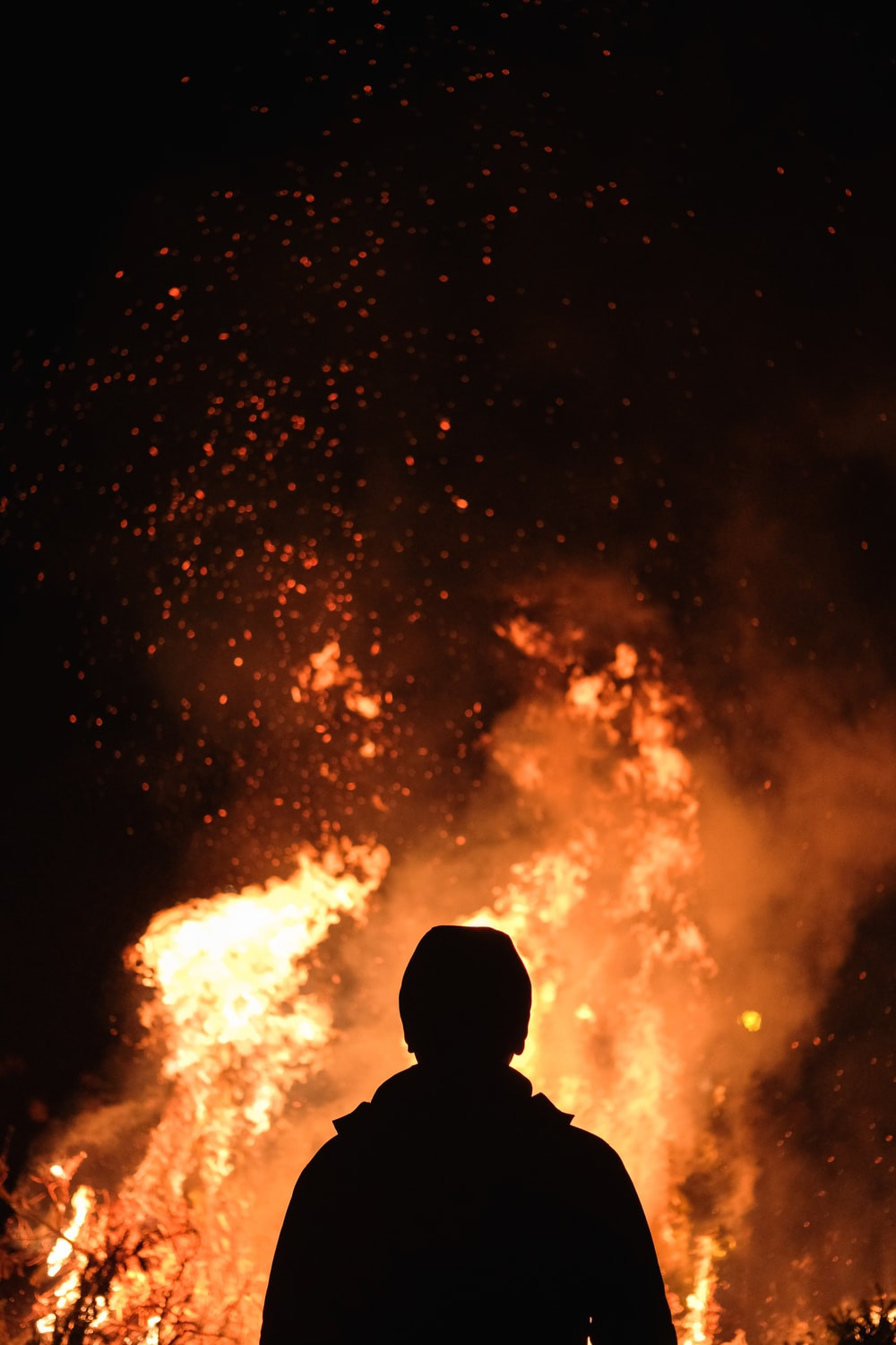 person standing in front of fire photo – Free Fire Image on Unsplash