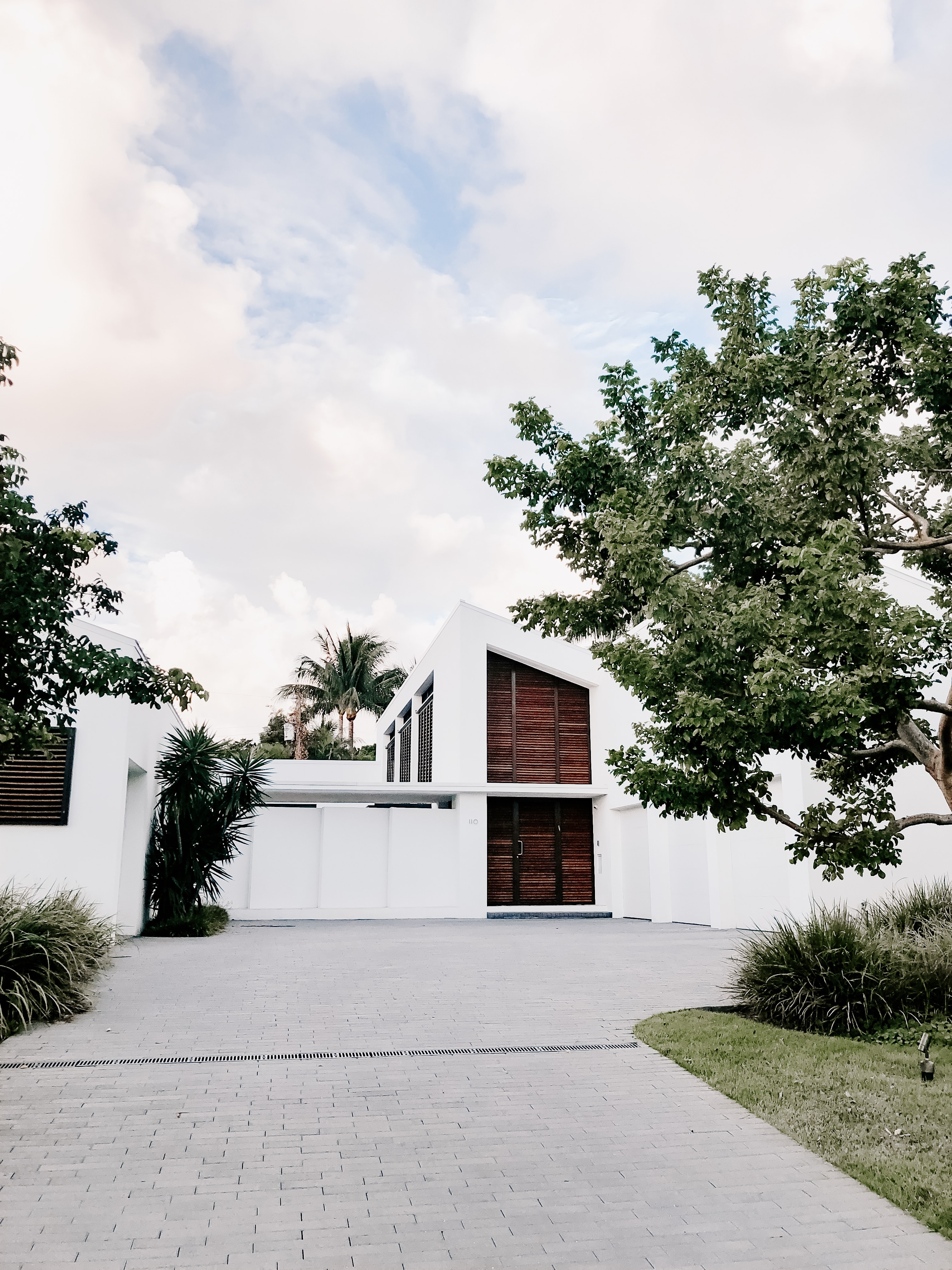 white concrete house surrounded with trees