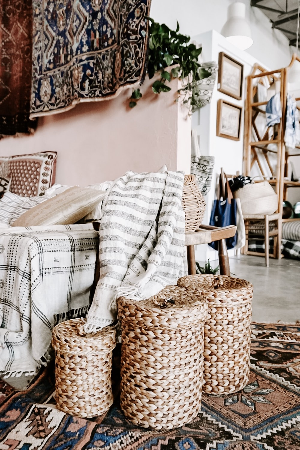 empty sofa with three woven nesting baskets