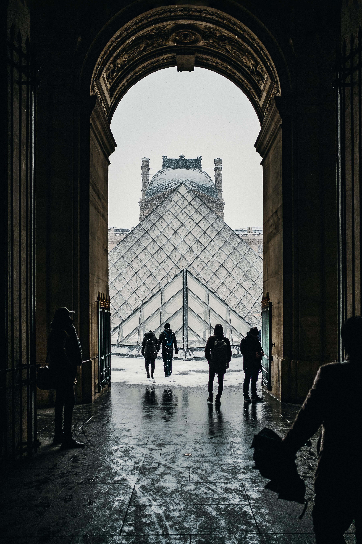 people walking under arch