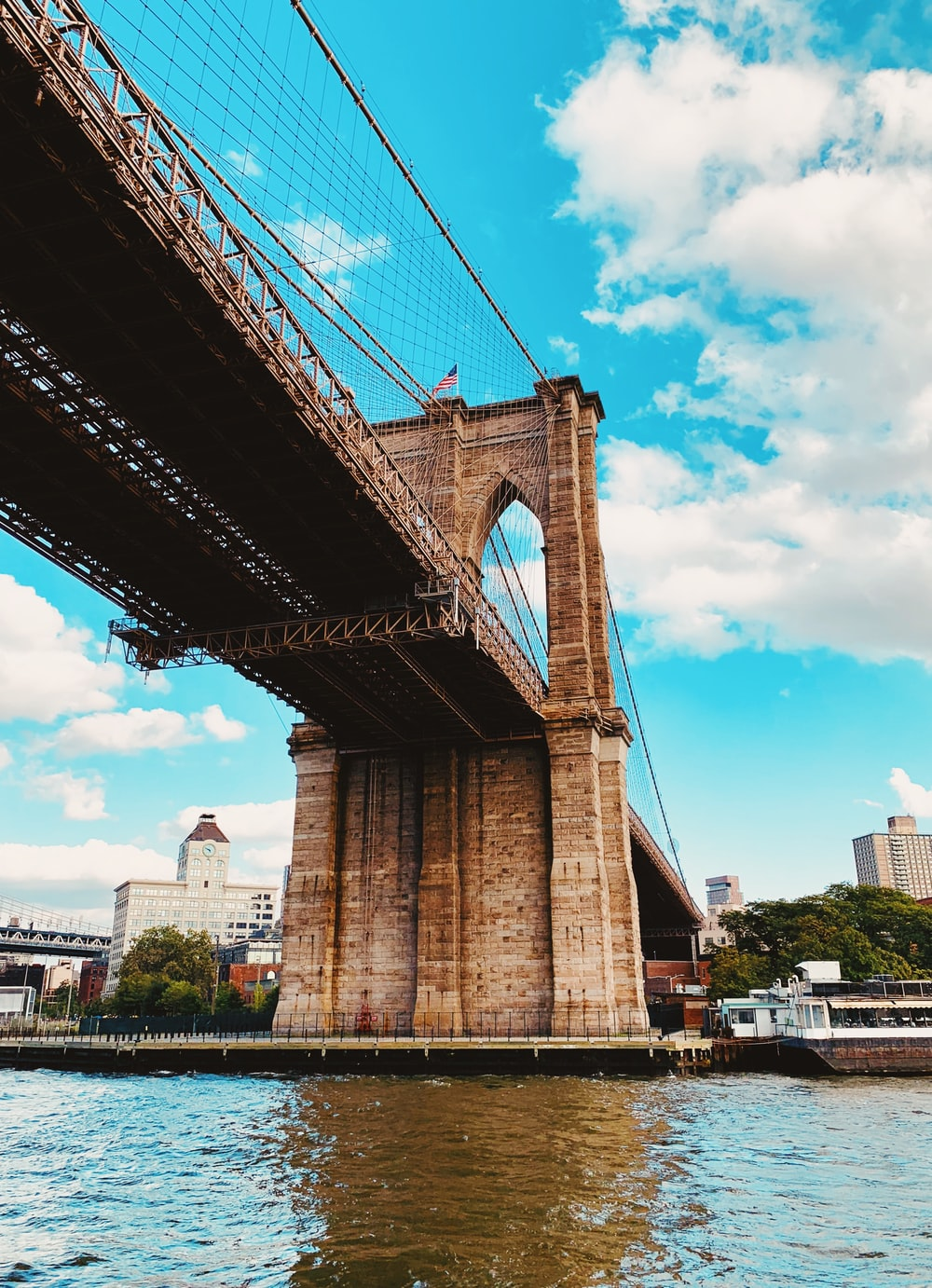low angle photography of Brooklyn Bridge under white sky