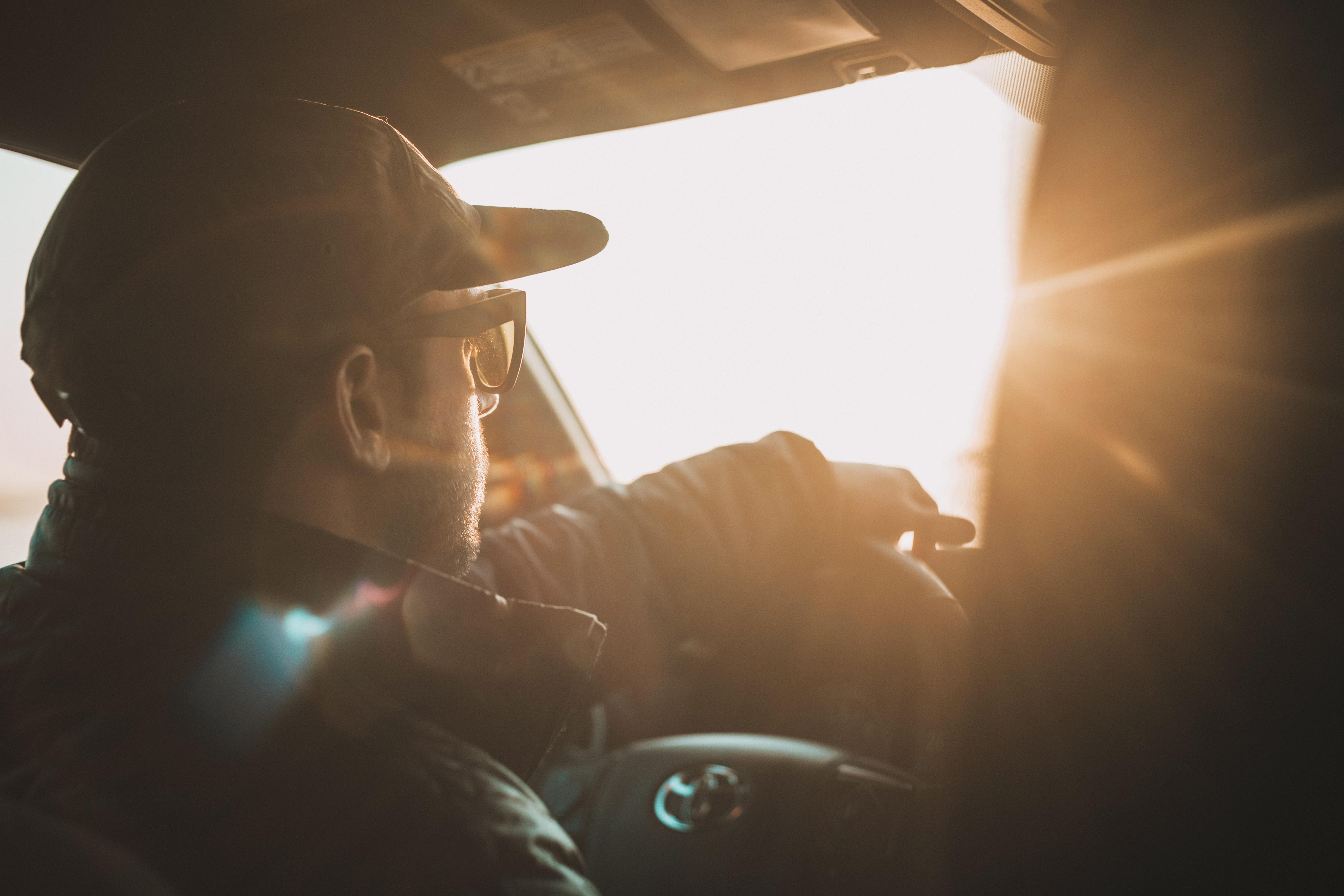 man driving Toyota vehicle during daytime