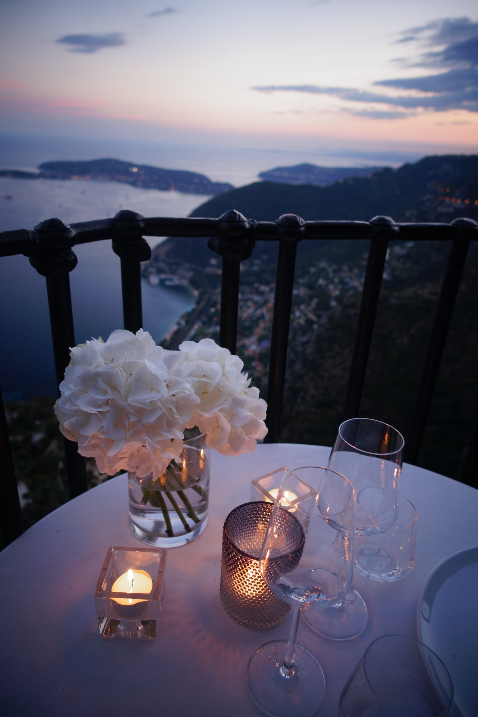 Wine glasses, candles and flowers