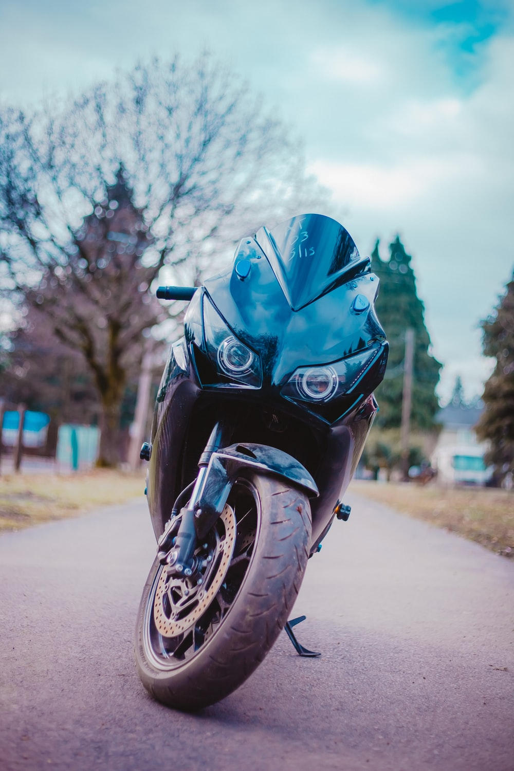 selective focus photography of sports bike parked on road