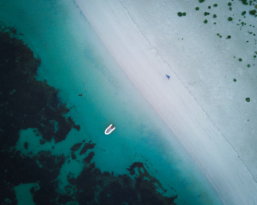 boat on ocean in aerial photography