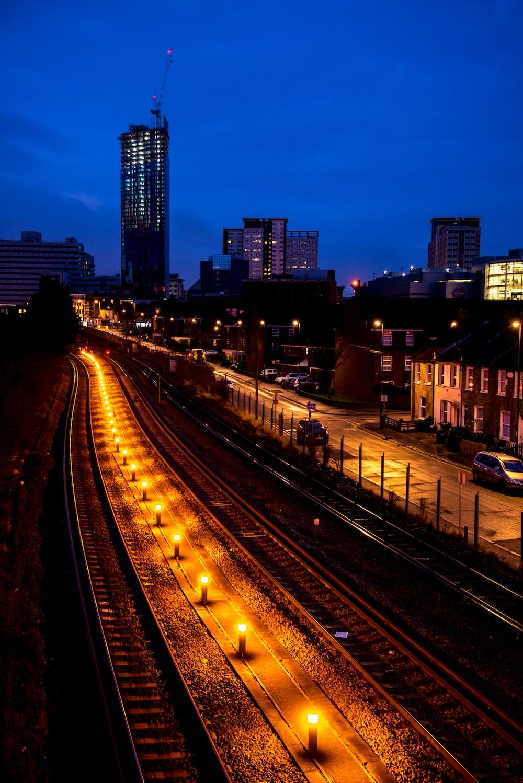 lighted rail near buildings