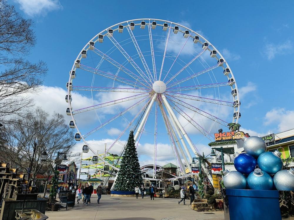 Christmas tree near huge white Ferris wheel