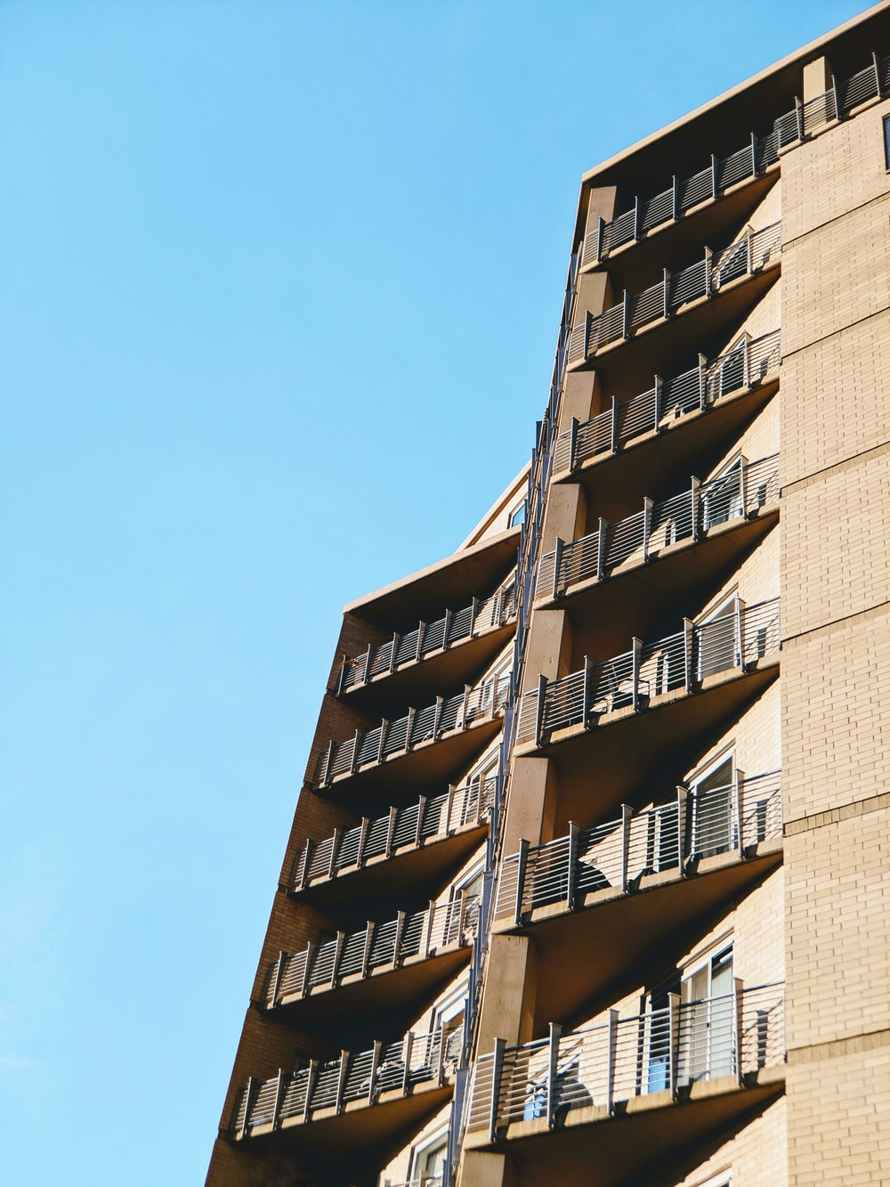 beige concrete building at daytime