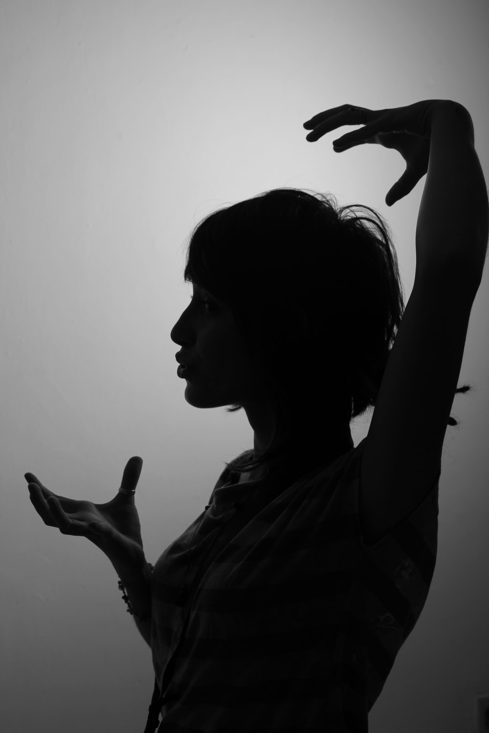 woman raising left and right hands