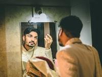 man facing at the mirror