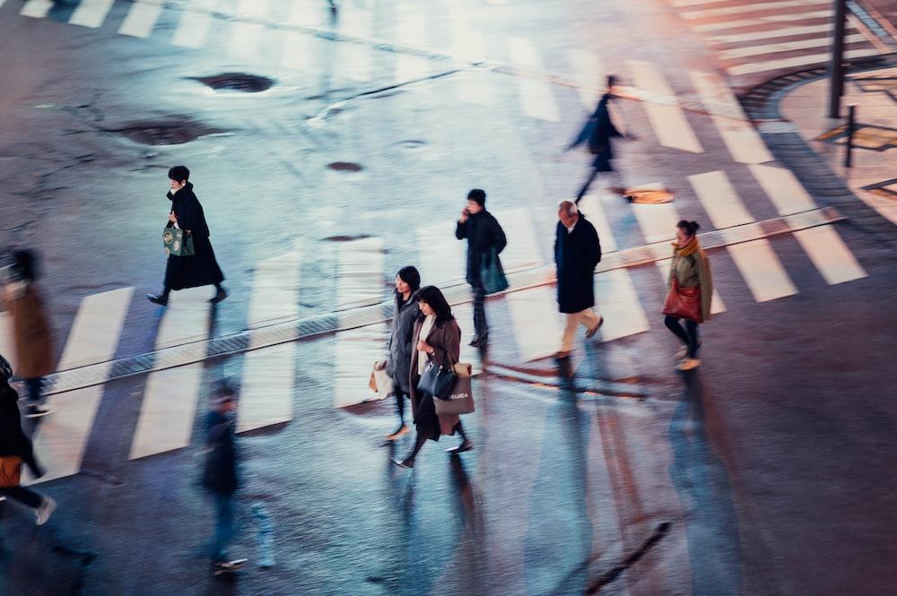 people crossing pedestrian lane at nighttime