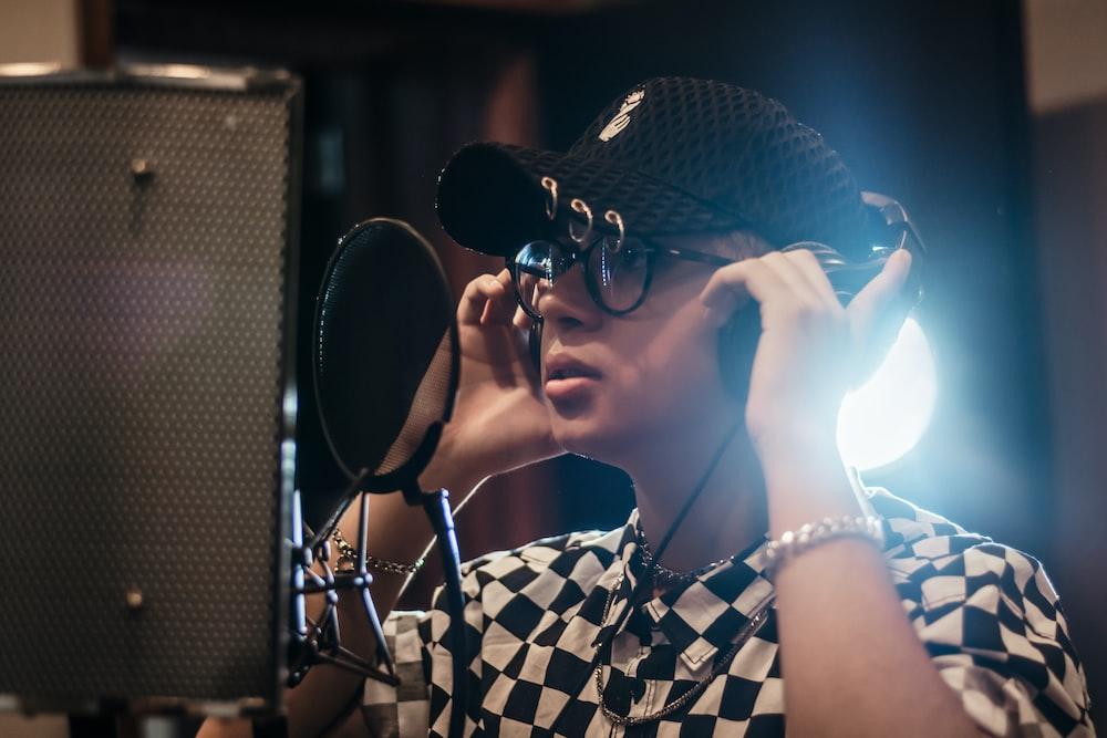 man recording his song