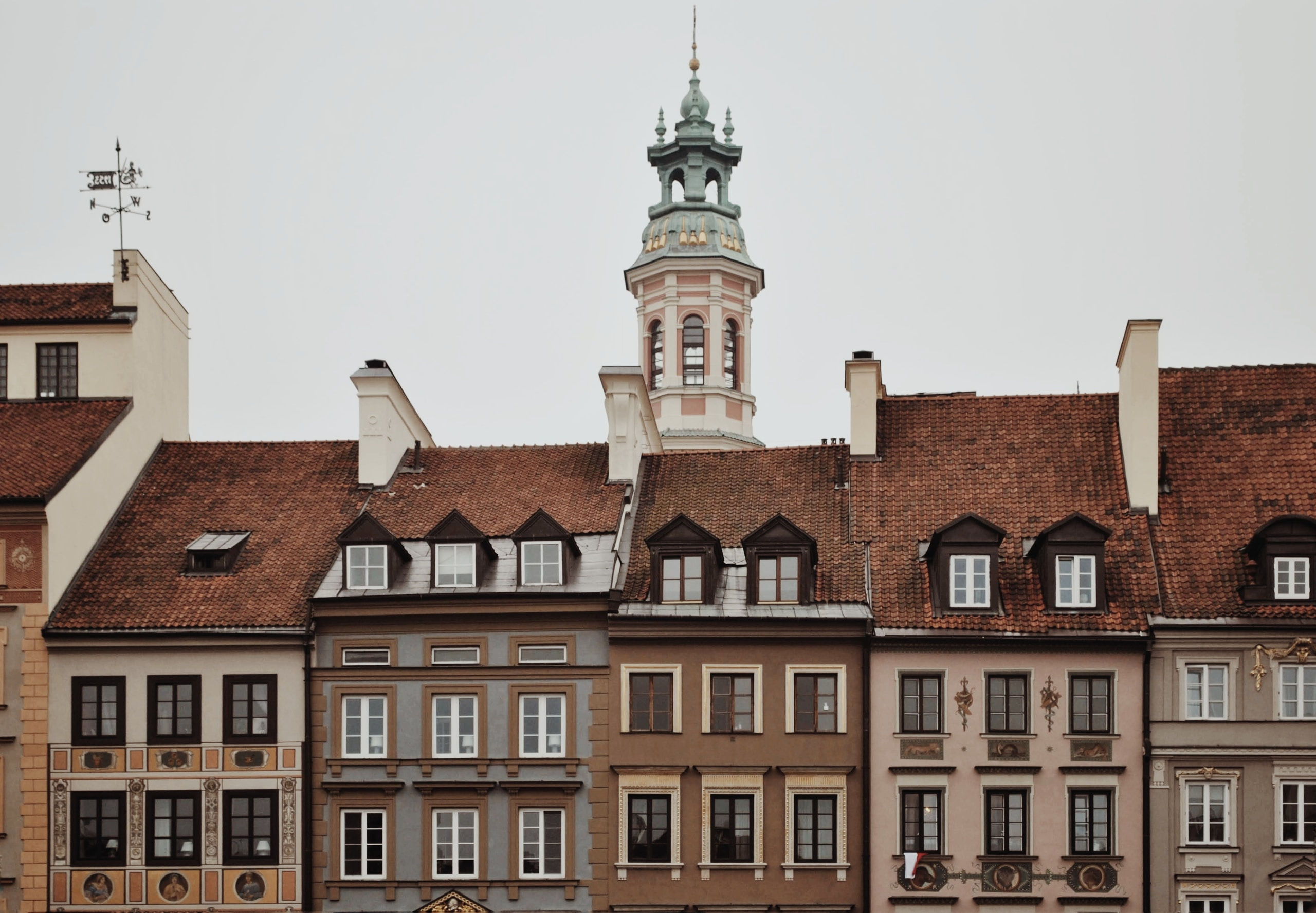 brown and white buildings under white sky