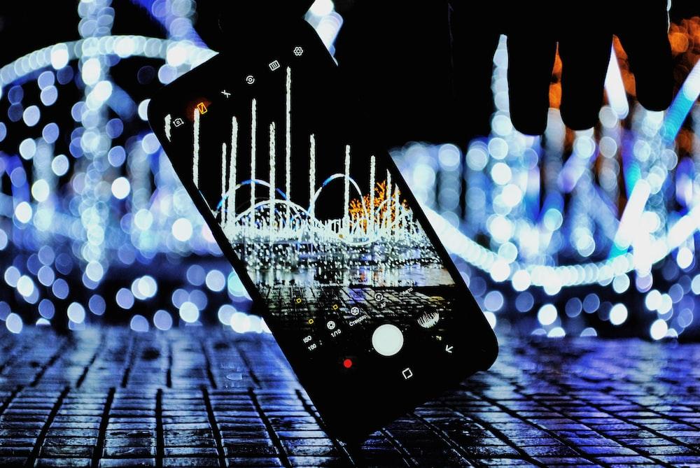 turned-on black smartphone
