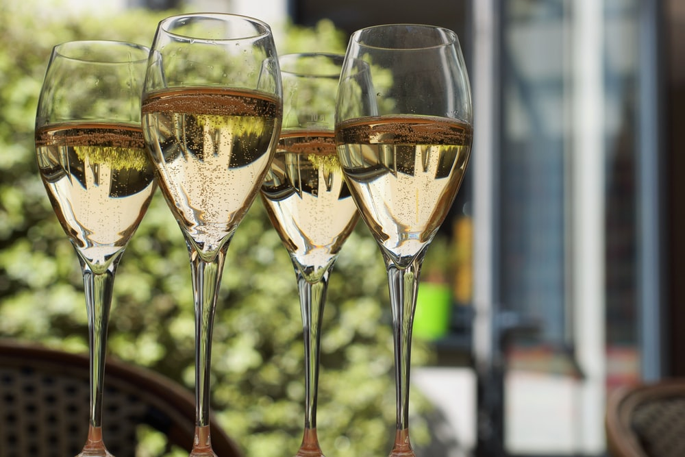shallow focus photo of footed wine glasses
