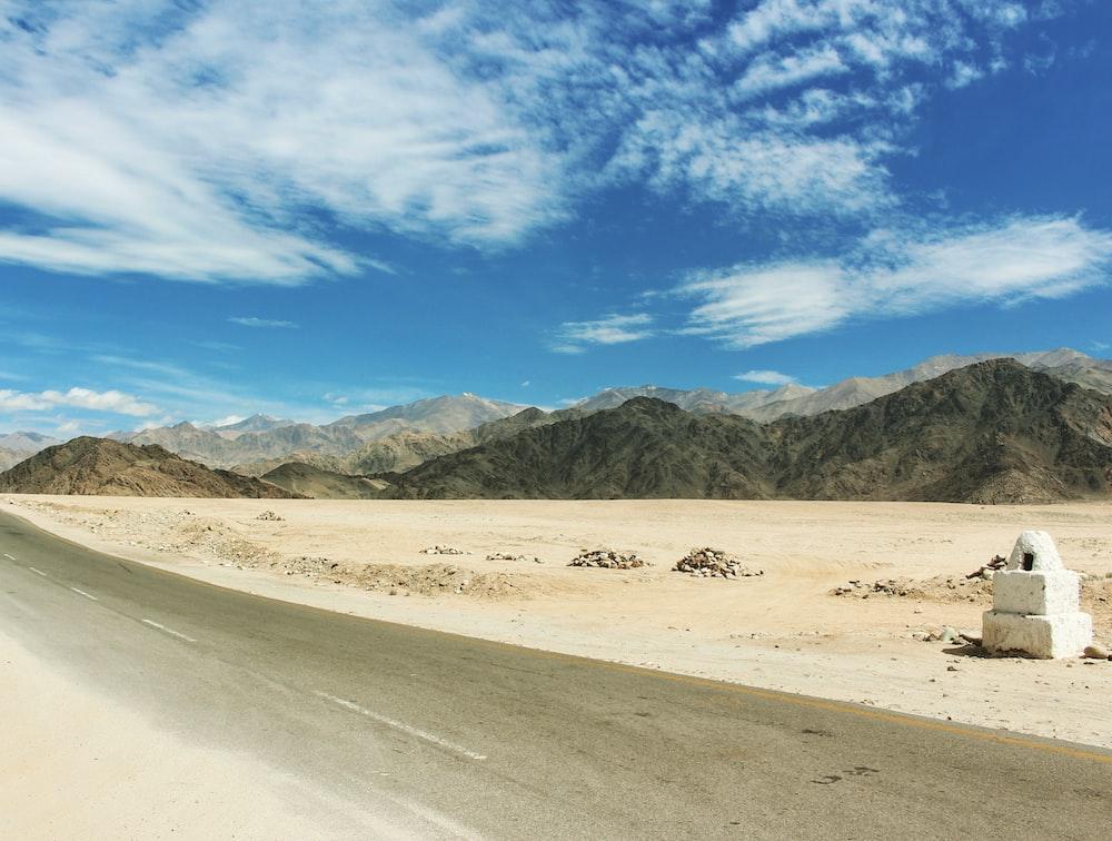 gray concrete road with range mountain view