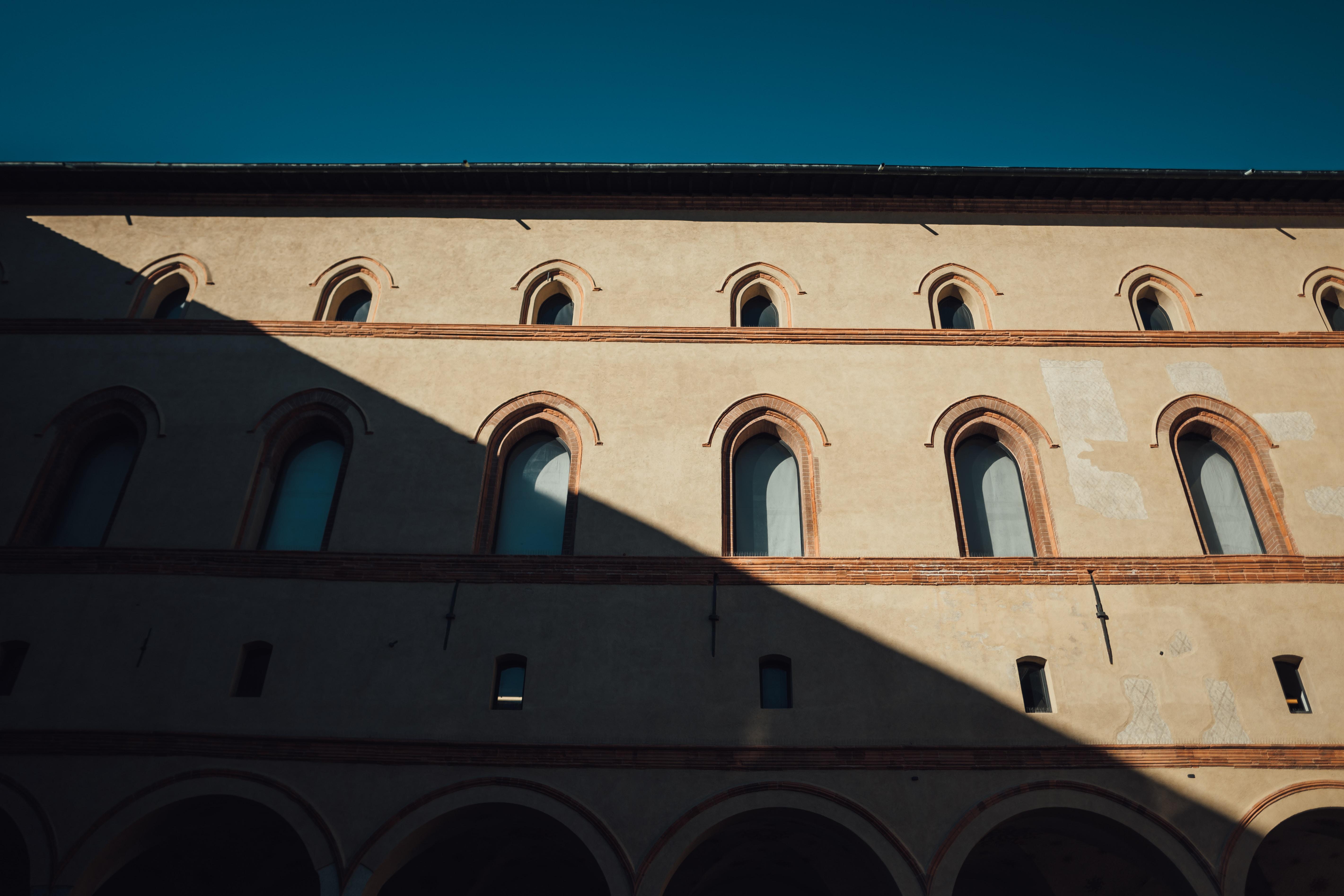 sun shining over a beige concrete building