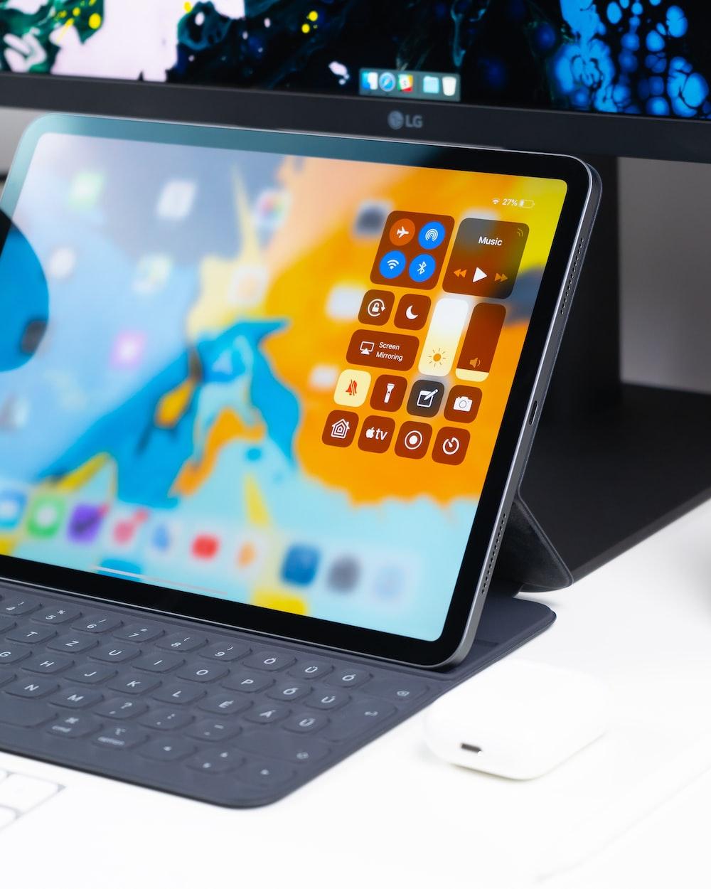 turned on tablet computer on white desk