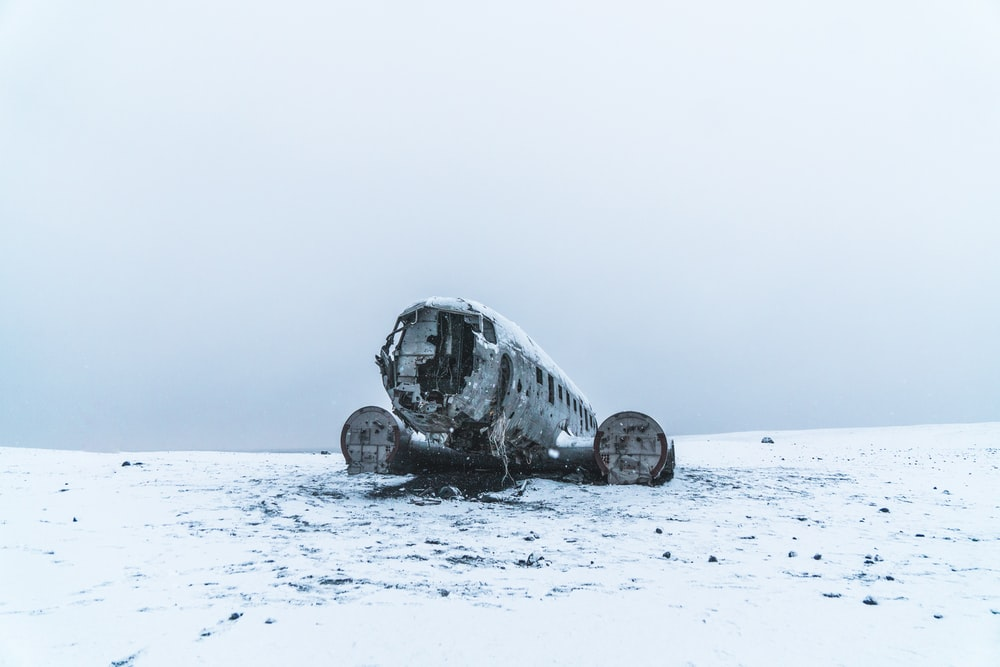 wrecked airplane on white snow covered field