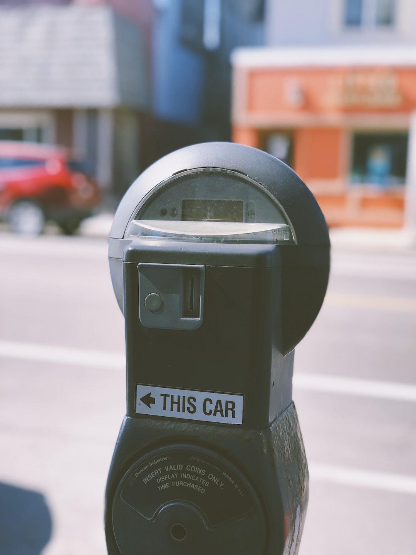 black car parking machine during daytime