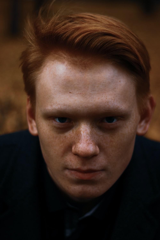 man wearing black top close-up photo