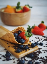 blueberry and strawberry in cone