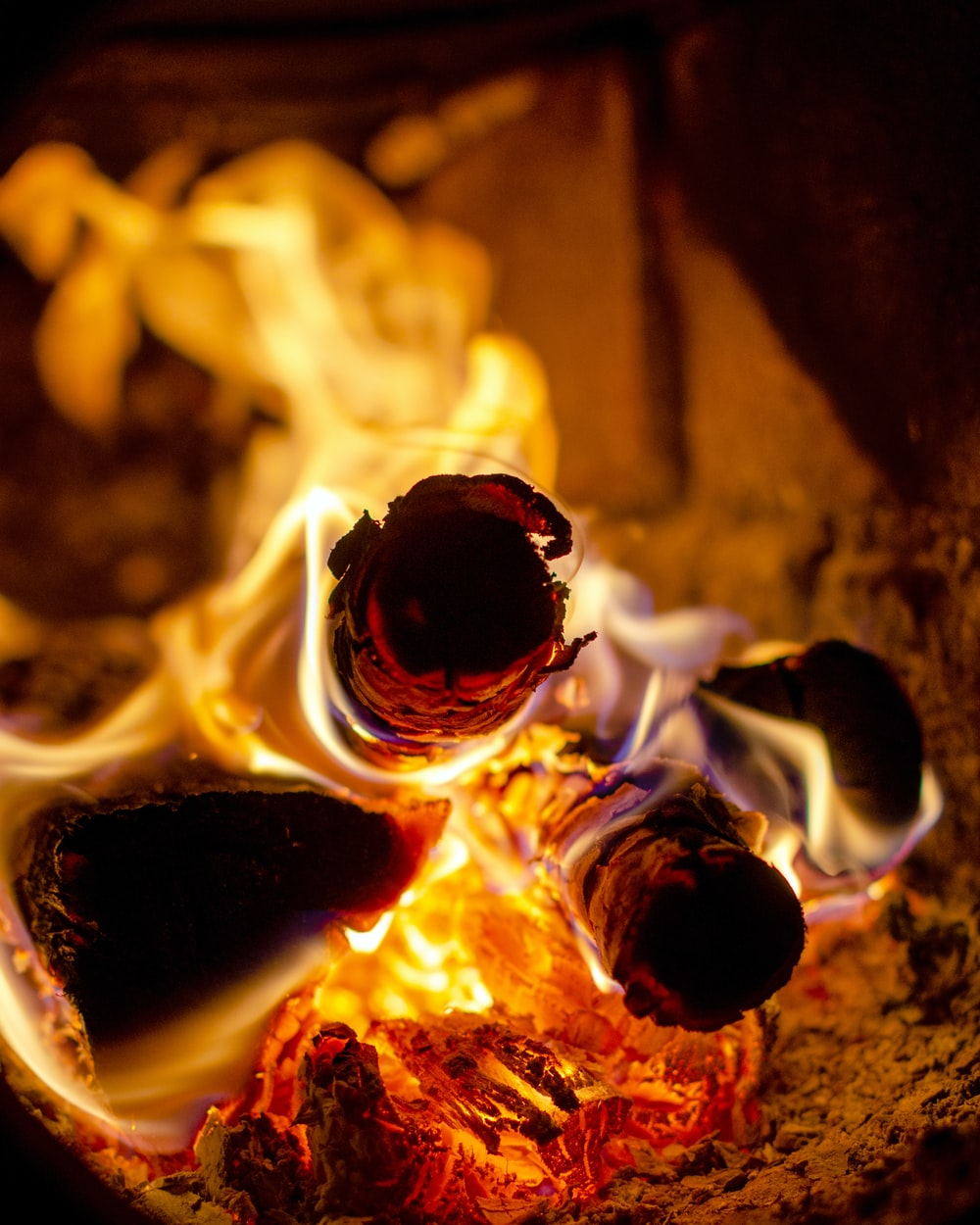 selective focus photography of wood with fire