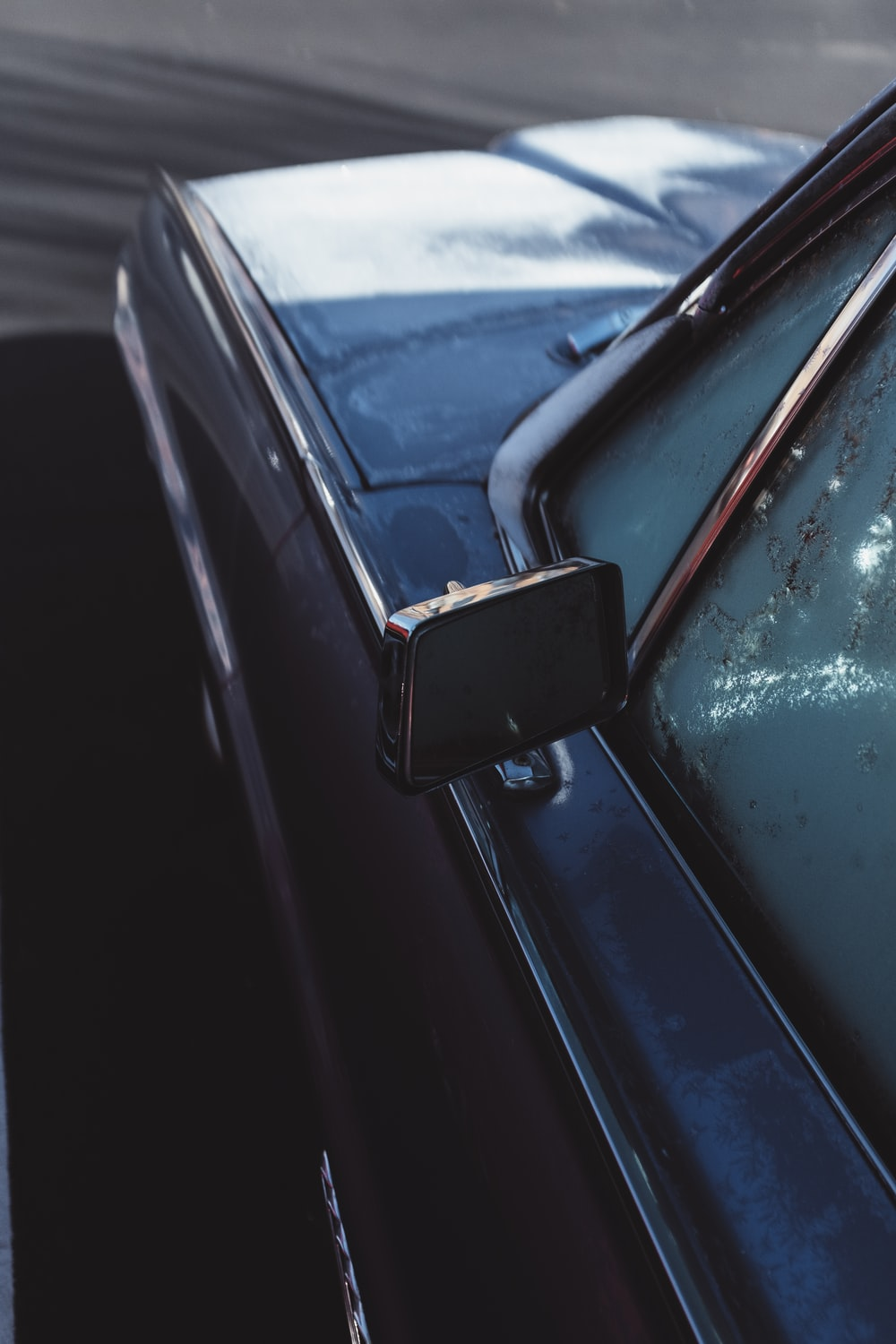 silver car with rectangular side mirror