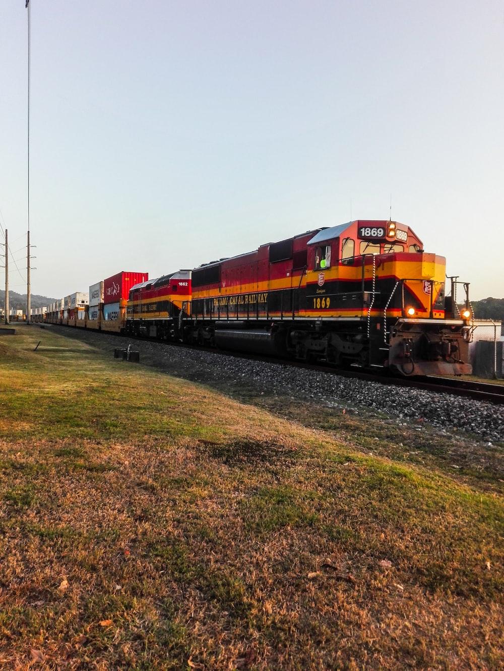 orange train under white sky during daytime