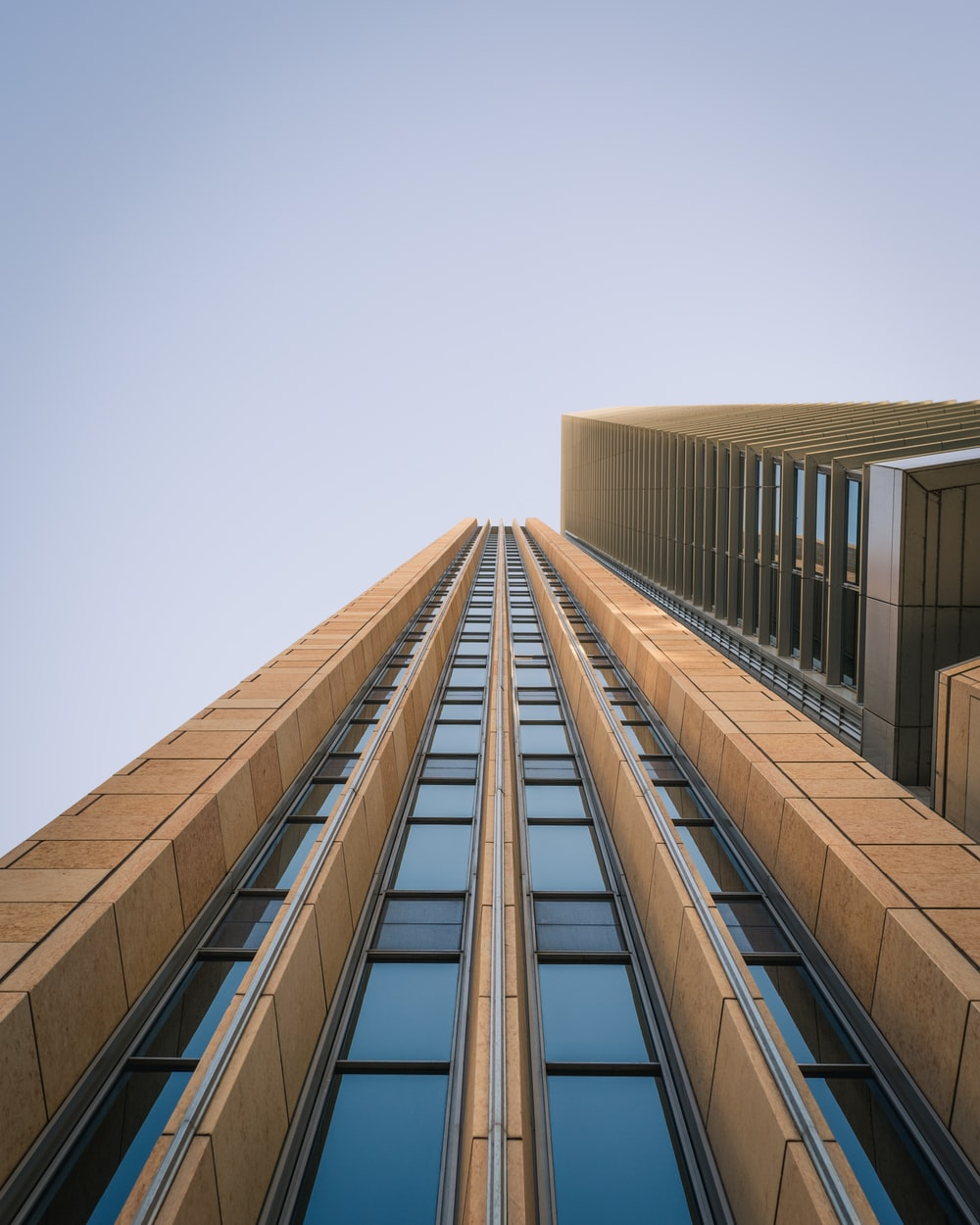 low angle photography of brown high-rise building during daytime