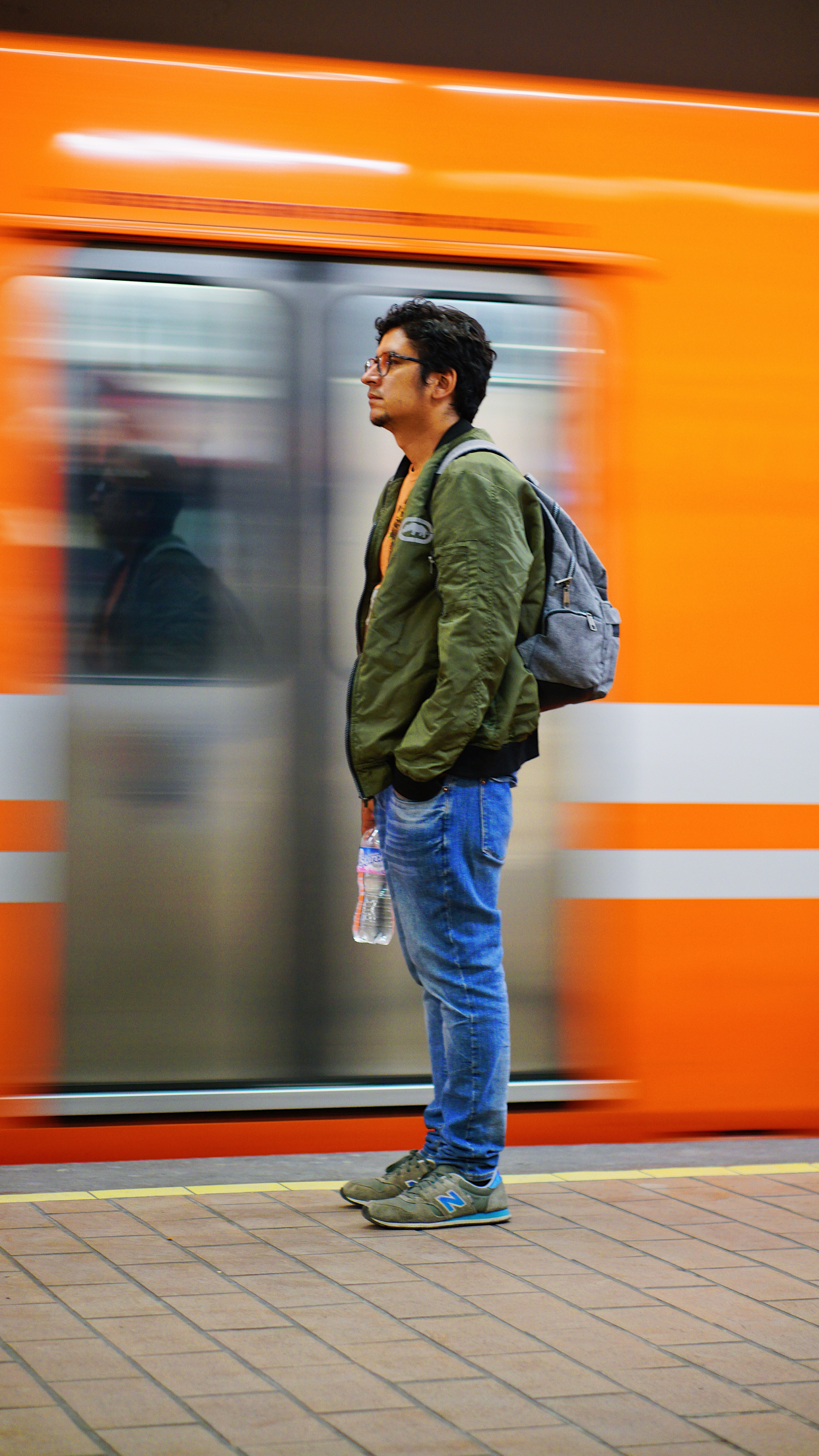 time lapse photography of train beside man