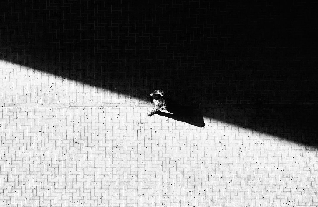 Follow me instagram: https://www.instagram.com/kent.tupas/  Looking down from our balcony, i saw this nice long shadow of the building. And i thought it would be interesting to wait for someone to pass by.