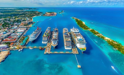 aerial photography of white and blue cruise ships during daytime bahamas zoom background