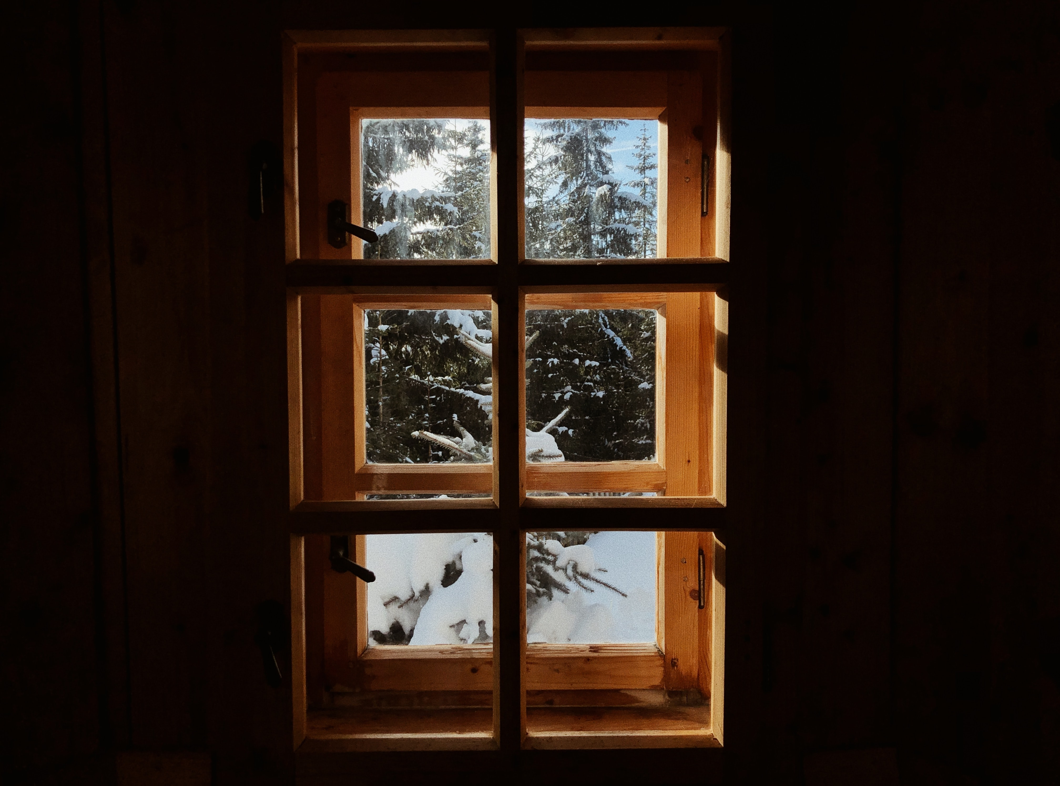 closed brown wooden framed clear glass window