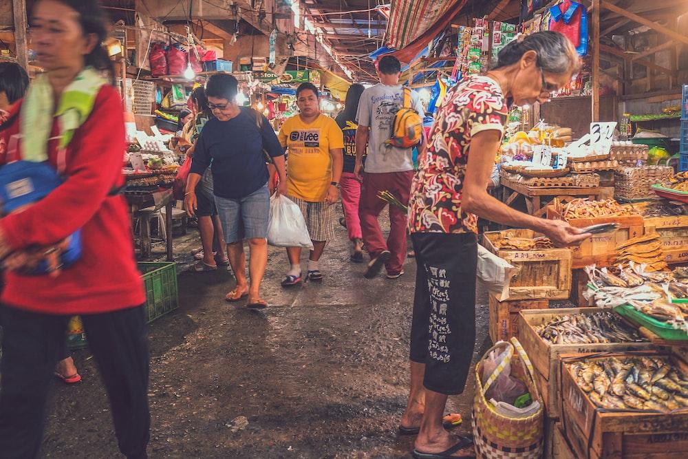 people walking on market store