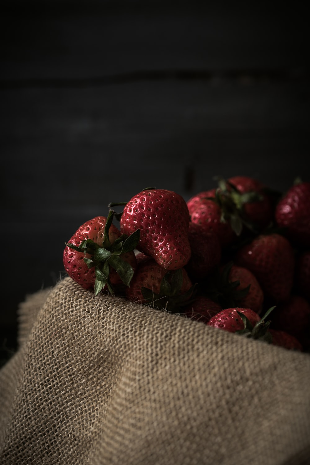 strawberries on brown textile