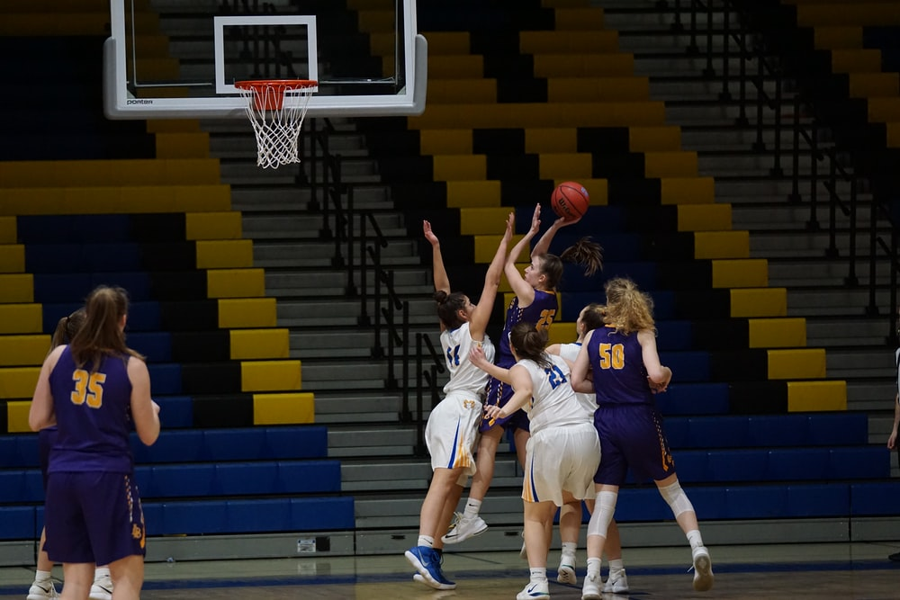 female playing basketball