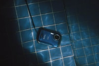 blue point-and-shoot camera