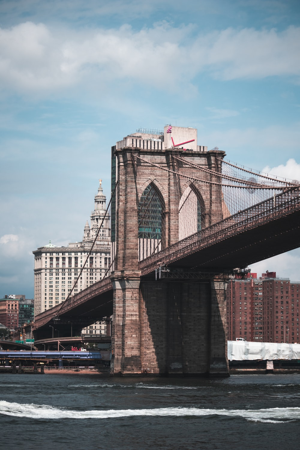 low angle photography of Brooklyn Bridge during daytime