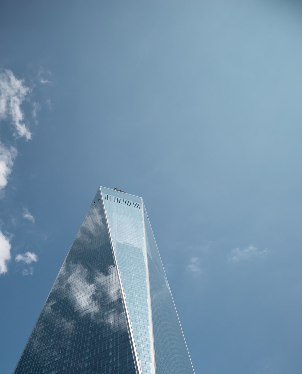 low-angle photography of curtain wall building during daytime