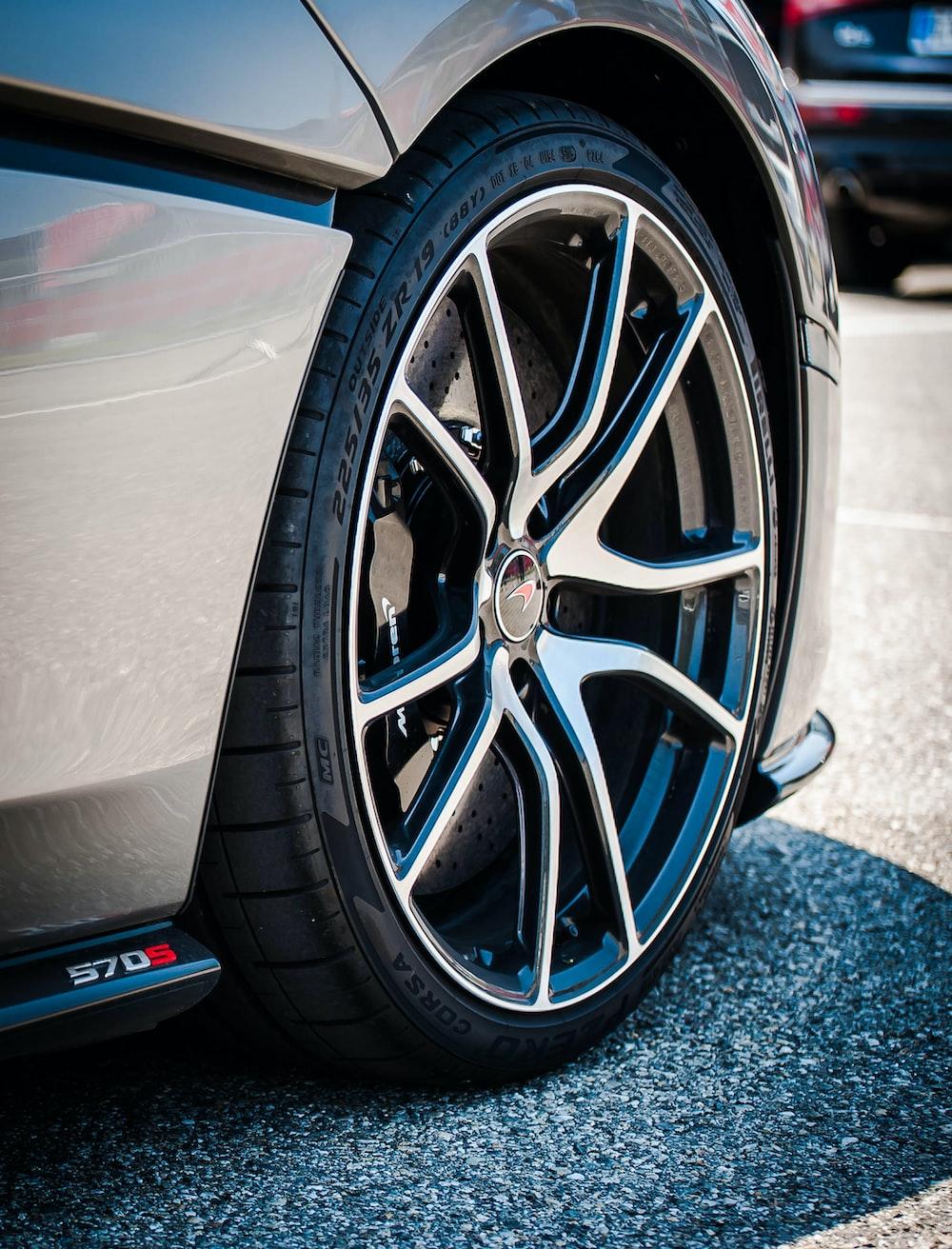 chrome multi-spoke wheel and black tire