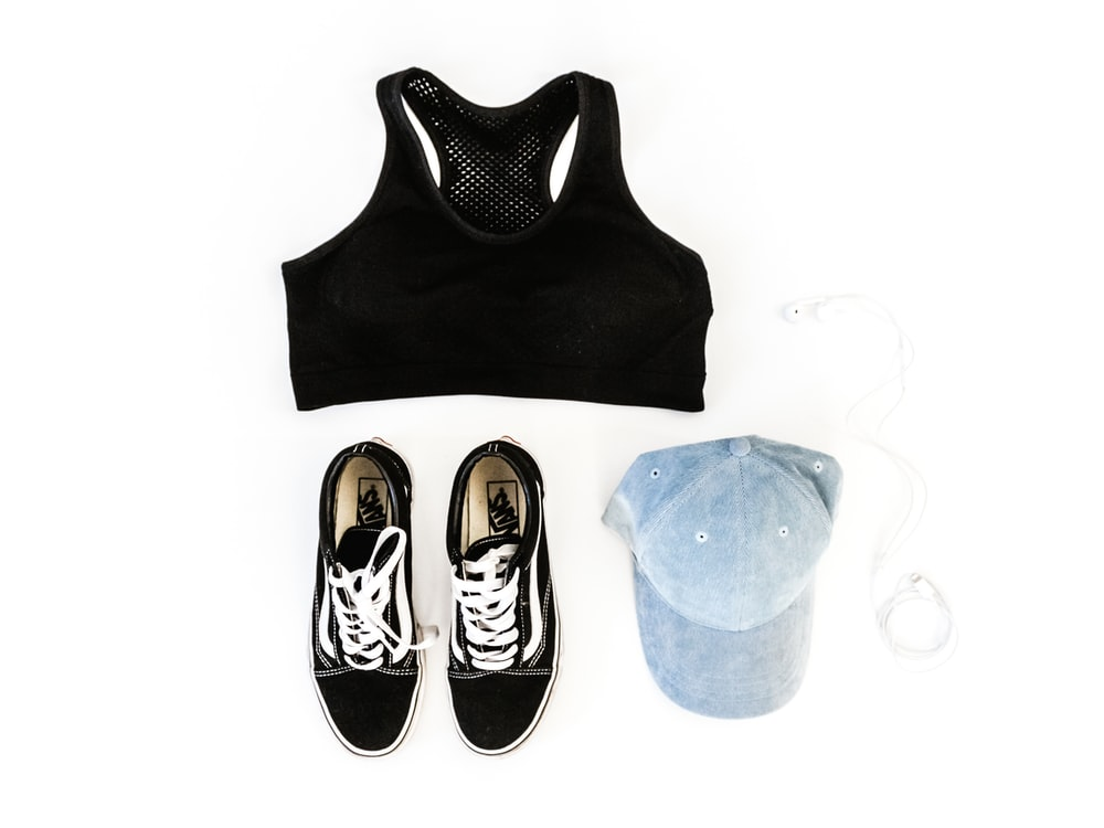 black sports bra and pair of black Vans low-top sneakers