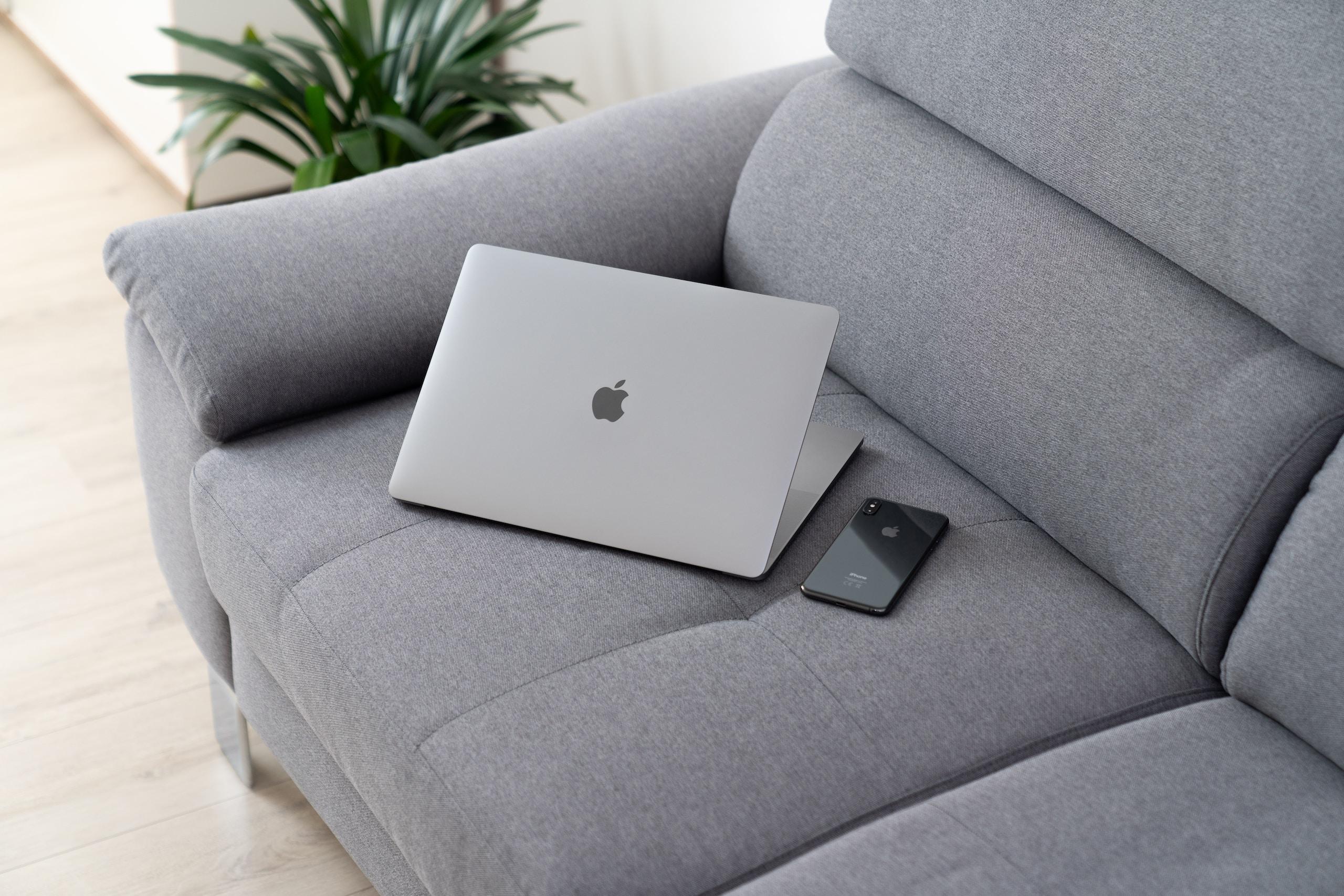 MacBook on grey sofa