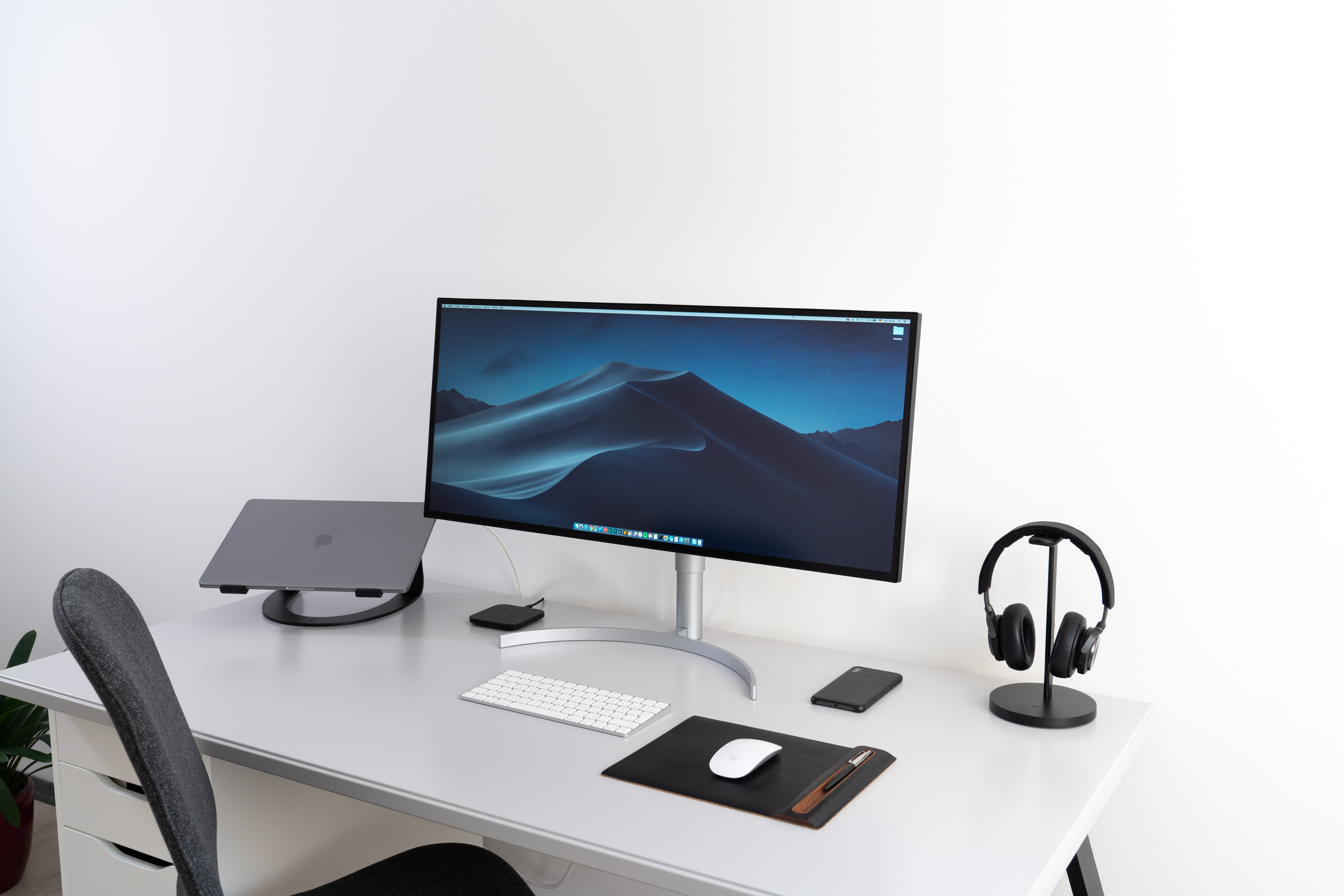 black flat widescreen computer monitor with with Apple Magic Keyboard and mouse on desk