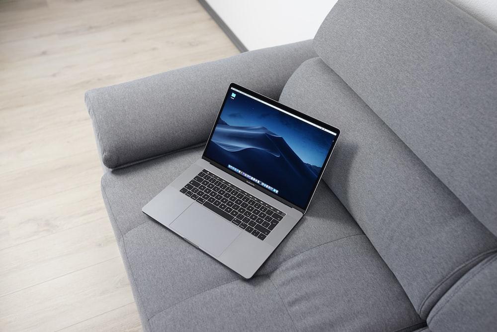 MacBook Pro on gray sofa