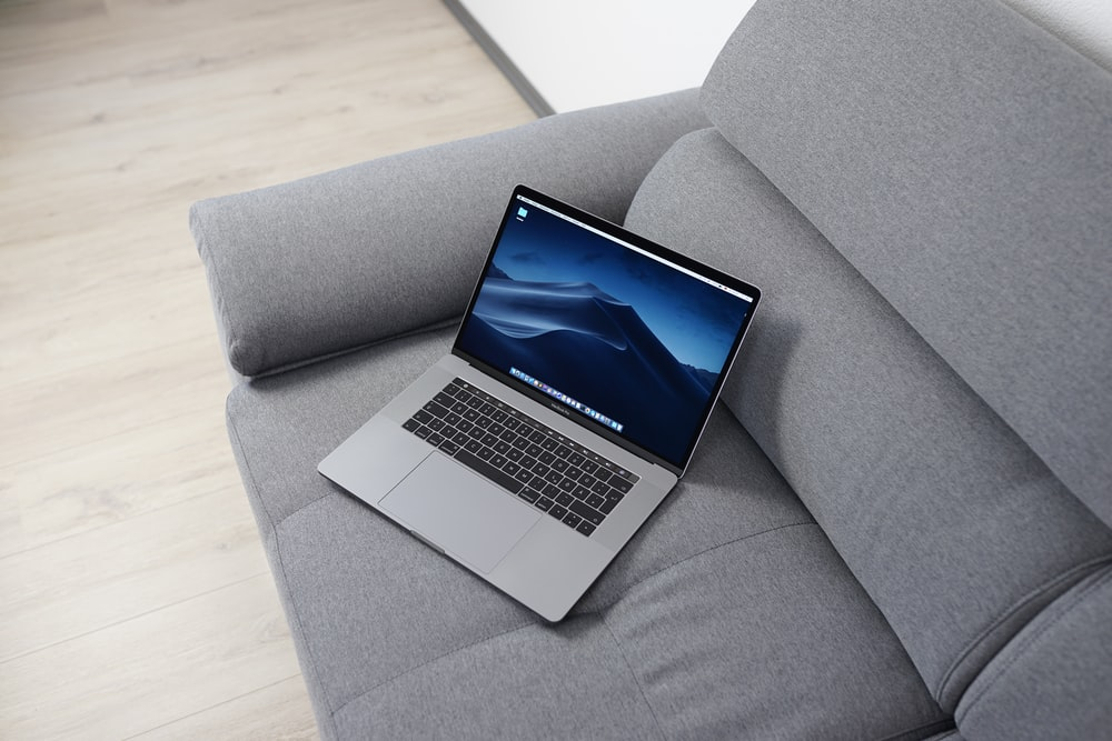 MacBook Pro on gray sofa