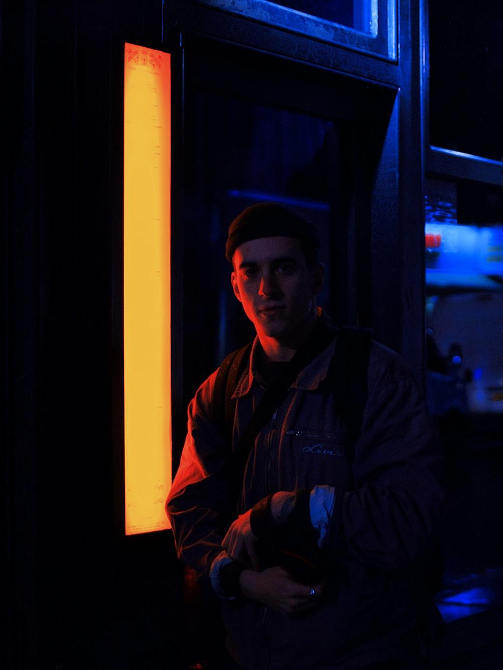 man standing beside street light