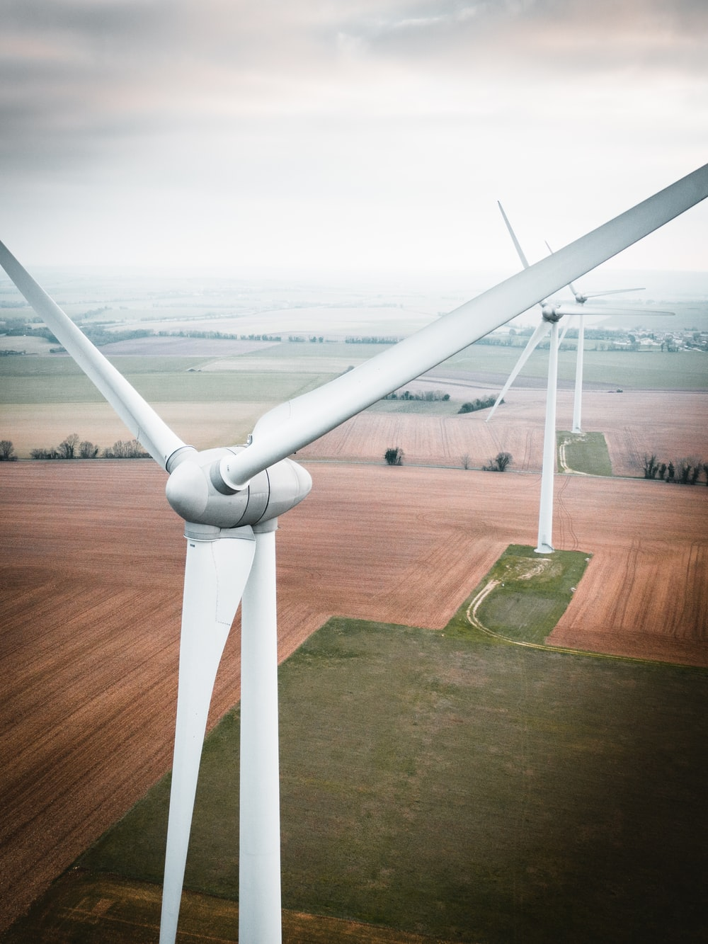 three white windmill during daytime