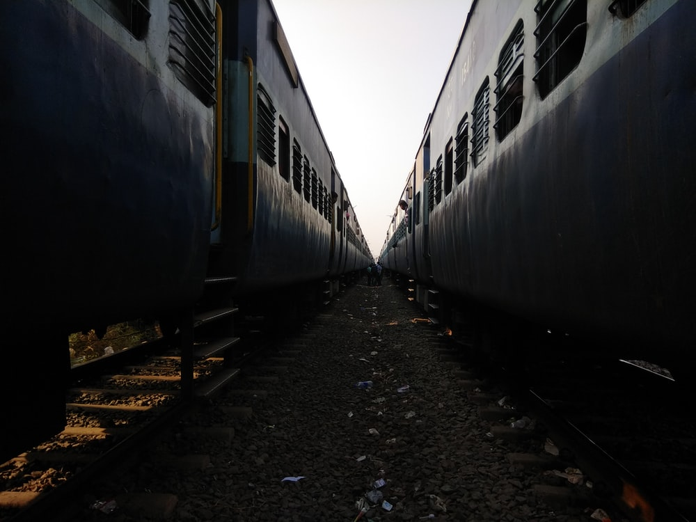 close-up photography of two trains