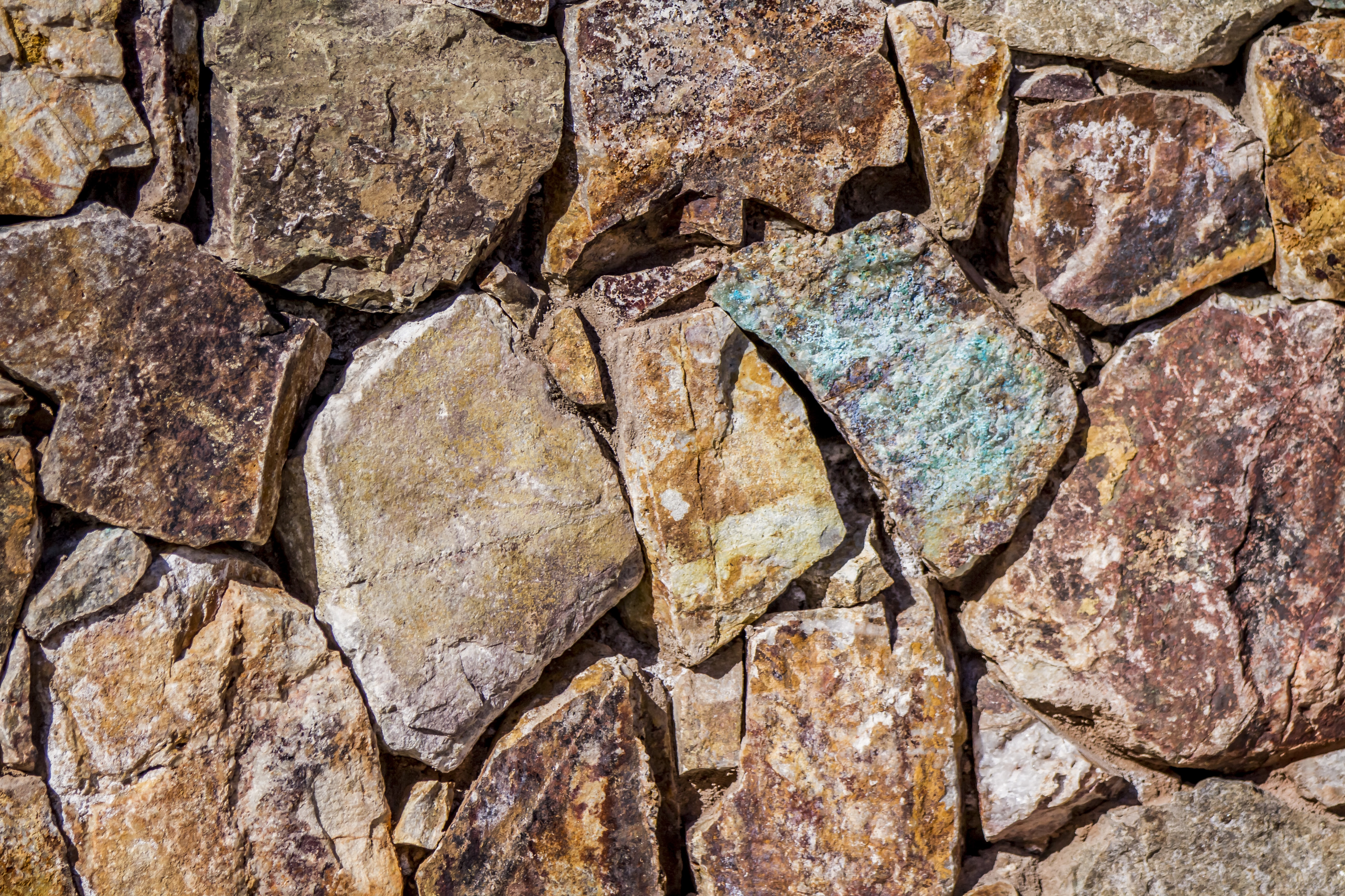close up photo of assorted-colored piled rocks